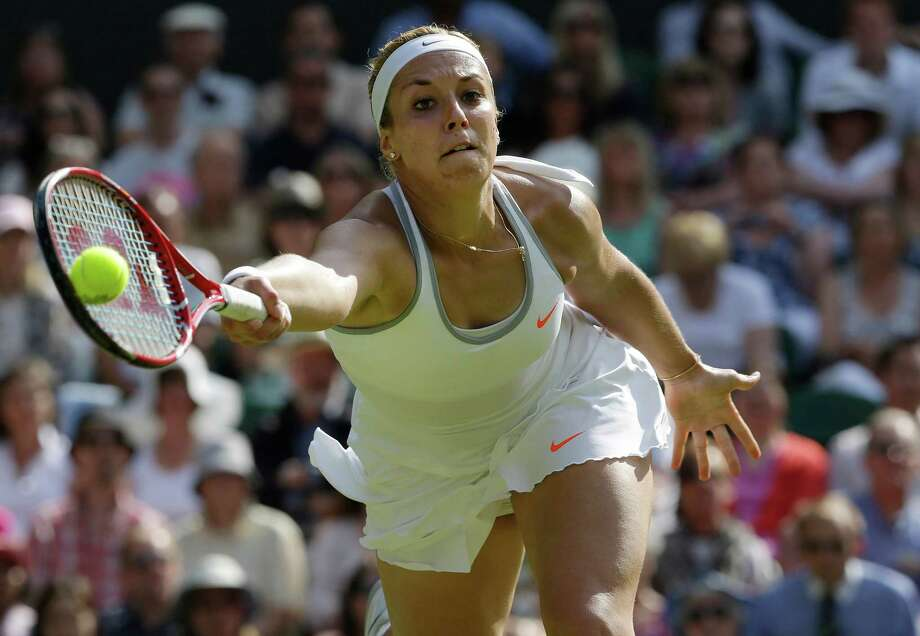 Sabine Lisicki of Germany plays a return to Agnieszka Radwanska of Poland during their Women's singles semifinal match at the All England Lawn Tennis Championships in Wimbledon, London, Thursday, July 4, 2013. (AP Photo/Anja Niedringhaus)  ORG XMIT: WIM321 Photo: Anja Niedringhaus, AP / AP