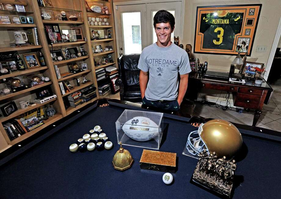 Andrew Cupero stands in his game room with wall-to-wall  sports memorabilia and a dream to walk on to the Notre Dame soccer team.  In a few months Cupero will see if his dream will come true.  Photo taken Wednesday, June 26, 2013. Photo taken: Randy Edwards/The Enterprise Photo: Randy Edwards