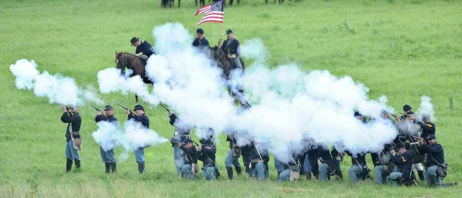 Civil War re-enactors commemorate the 150th anniversary of the Battle of Gettysburg. A reader expressed disappointment that a chart accompanying a recent story on the anniversary failed to list the number of U.S. casualties during the Vietnam War.  Photo: Jason Plotkin, Associated Press / York Daily Record/Sunday News