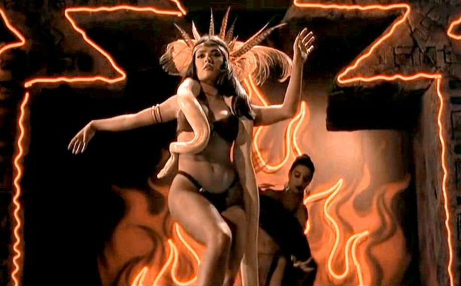 "Salma Hayek played the bikini-wearing, snake-wielding Santanico Pandemonium in 1996's ""From Dusk Till Dawn."""