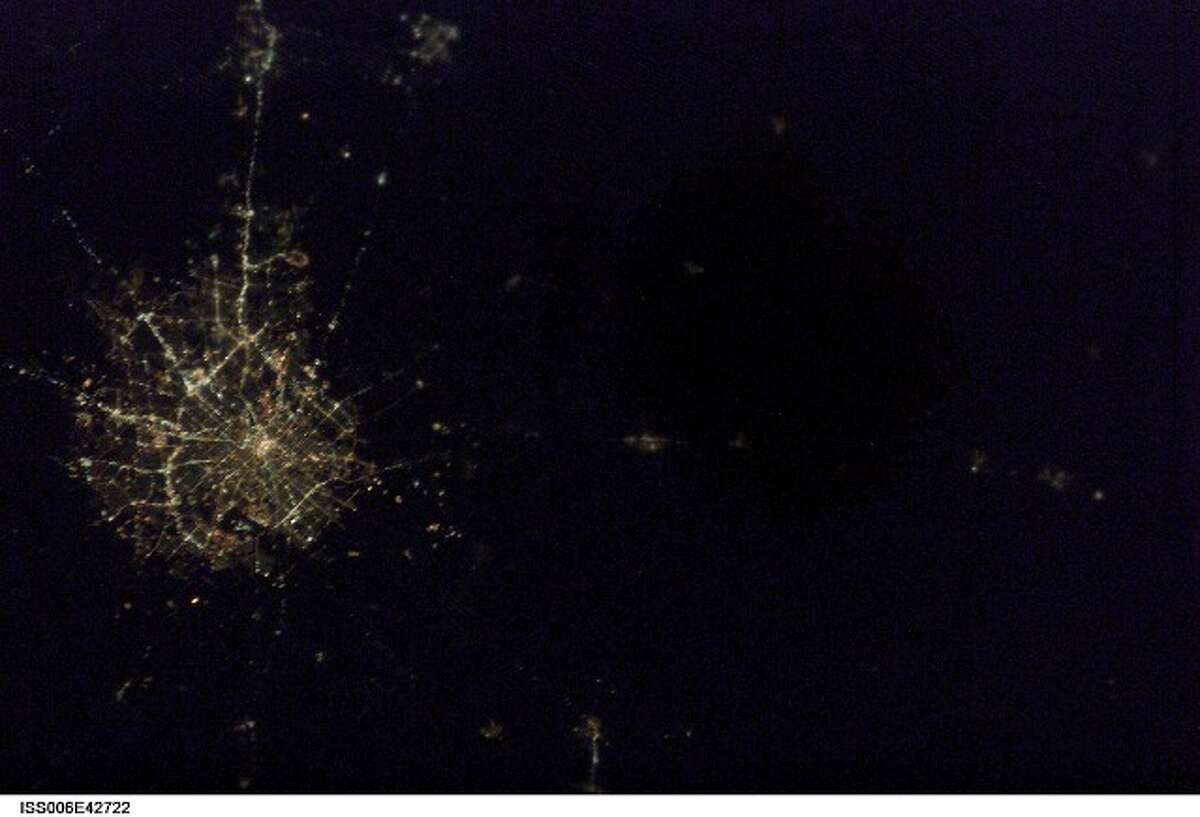 This NASA photo from space shows San Antonio at night. Click ahead to see ground-level photos of Alamo City lights at night by Express-News Staff Photographer Tom Reel.
