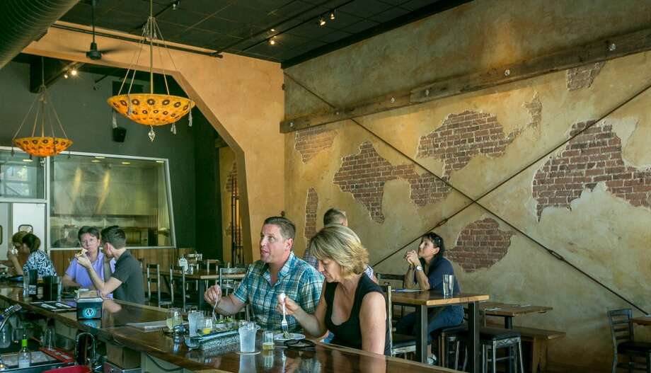 People enjoy lunch at Belly Left Coast Kitchen & Tap Room in Santa Rosa, Calif., on Saturday,  June 29th, 2013.