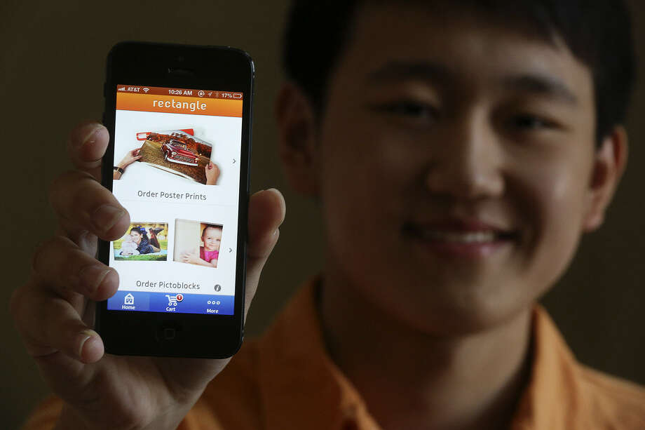 "Canzhi Ye's free iPhone app, ""Rectangle,"" lets users order photo prints directly from the smartphone to their home. Photo: Lisa Krantz / San Antonio Express-News"