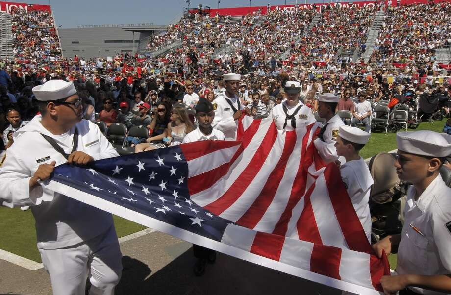 U.S. Naval Sea Cadets, Matt Drabek, (left) and Jeremiah Lahaina, (right) along with fellow Cadets,  parade in the United States colors to begin the opening day ceremony at America's Cup Park in San Francisco, Calif., on Thursday July 4, 2013. America's Cup Park opens along the Embarcadero launching the first day of the summer of racing.