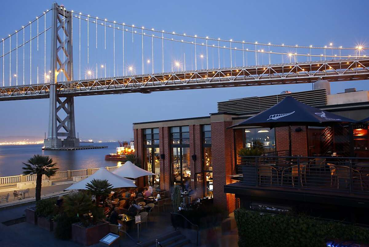 Waterbar (San Francisco)-The Waterbar at dusk with the Bay Bridge in the background in San Francisco on July 3, 2013.