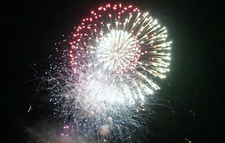 Bombs burst in air over Fairfield's shoreline, to the amazement of thousands, during the town's annual Independence Day fireworks display Thursday night. Photo: Genevieve Reilly / Fairfield Citizen