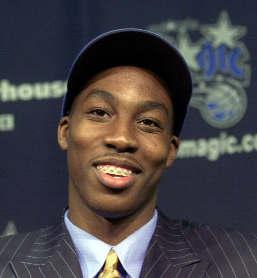 Howard, shown here wearing braces, made the jump from the preps to the pros in 2004. Photo: Peter Cosgrove), Associated Press