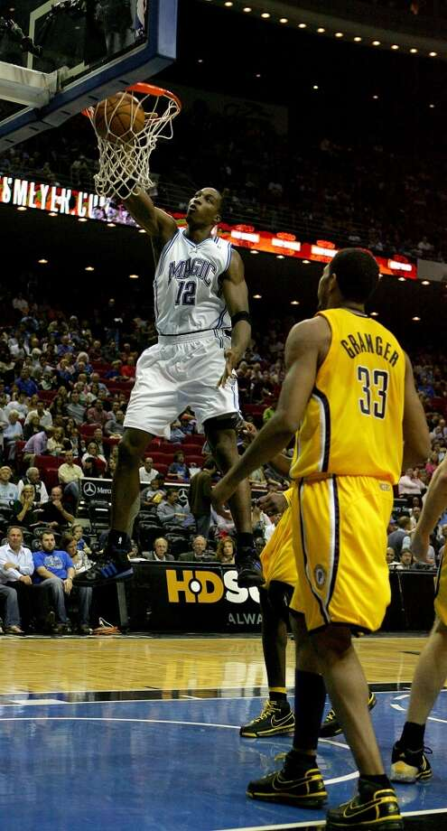 In Howard's fourth season as a pro he led the Magic to their first division title in 12 years and to the third seed in the 2008 playoffs. In the Magic's first-round matchup against the Raptors, Howard's dominance (three 20 point/20 rebound games) ensured that Orlando prevailed in five games. In the second round against the Pistons, the Magic lost the series 4–1. Photo: Sam Greenwood, Getty Images