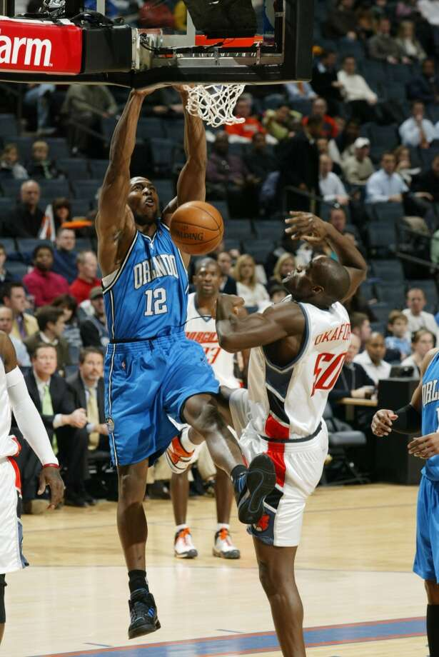 In arguably the most accomplished year of his career, Howard recorded his first triple double (30 points, 19 rebounds and 10 blocks), was named the NBA's Defensive Player of the Year for the first time in his career, was named to the All-NBA First Team and also led the Magic to the NBA Finals, where they lost to the Lakers in five games. Photo: Sporting News Archive, Sporting News Via Getty Images