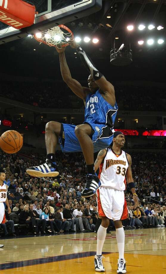 During the 2009-2010 season, Howard helped lead the Magic to their third consecutive division title. He was also named the NBA's Defensive Player of the Year for the second consecutive season. The Magic lost to the Celtics in the Eastern Conference Finals. Photo: Jed Jacobsohn, Getty Images