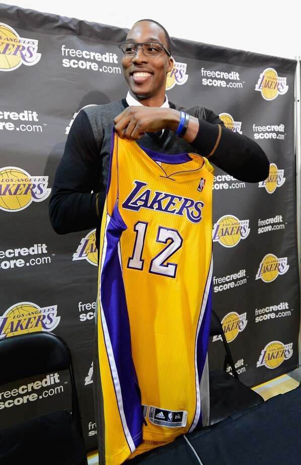 On August 10, 2012, Howard got his wish and was traded from the Magic to the Lakers in a three-way deal that also involved the 76ers and the Nuggets. The Lakers also received Chris Duhon and Earl Clark, the Magic received Josh McRoberts, Christian Eyenga, Maurice Harkless, Nikola Vucevic, Arron Afflalo, Al Harrington, and draft picks, while Philadelphia received Jason Richardson and Andrew Bynum and Denver received Andre Iguodala. Photo: Kevork Djansezian, Getty Images