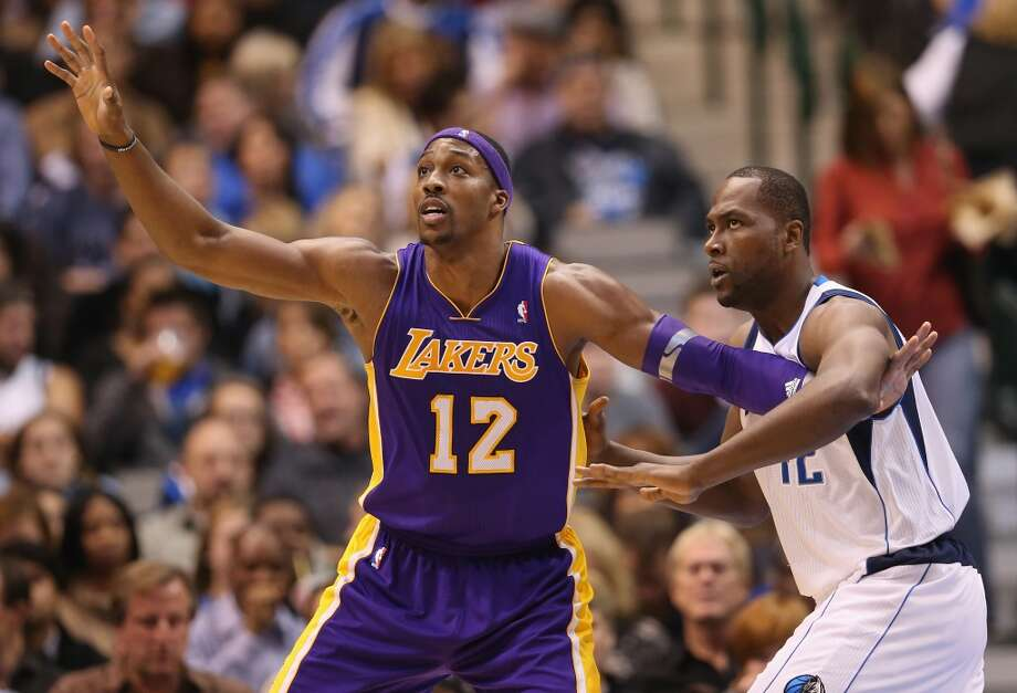In his first season with the Lakers, Dwight Howard found it hard to settle in to a basketball-crazy city with a larger-than-life superstar in Kobe Bryant. He oftentimes felt out of place and incapable of running coach Mike D'Antoni's offense. Photo: Ronald Martinez, Getty Images