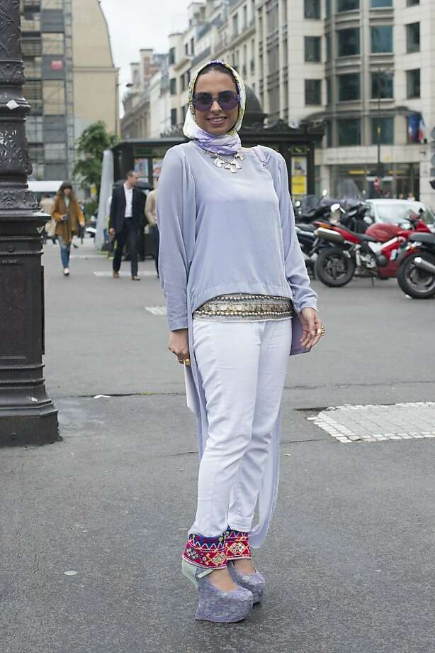Fashion student Aldrees Munirah wears Jeffrey Campbell shoes, an Octa bag, Zara trousers and headscarf, own design top, and Emporio Armarni glasses on day 3 of Paris Collections: Women's Haute Couture on July 03, 2013 in Paris, France.  (Photo by Kirstin Sinclair/FilmMagic) Photo: Kirstin Sinclair, FilmMagic