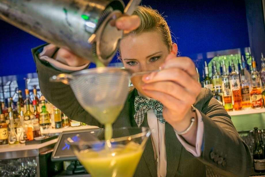 Bartender Jessamine McLellan makes the Zesty Martini at Hakkasan.