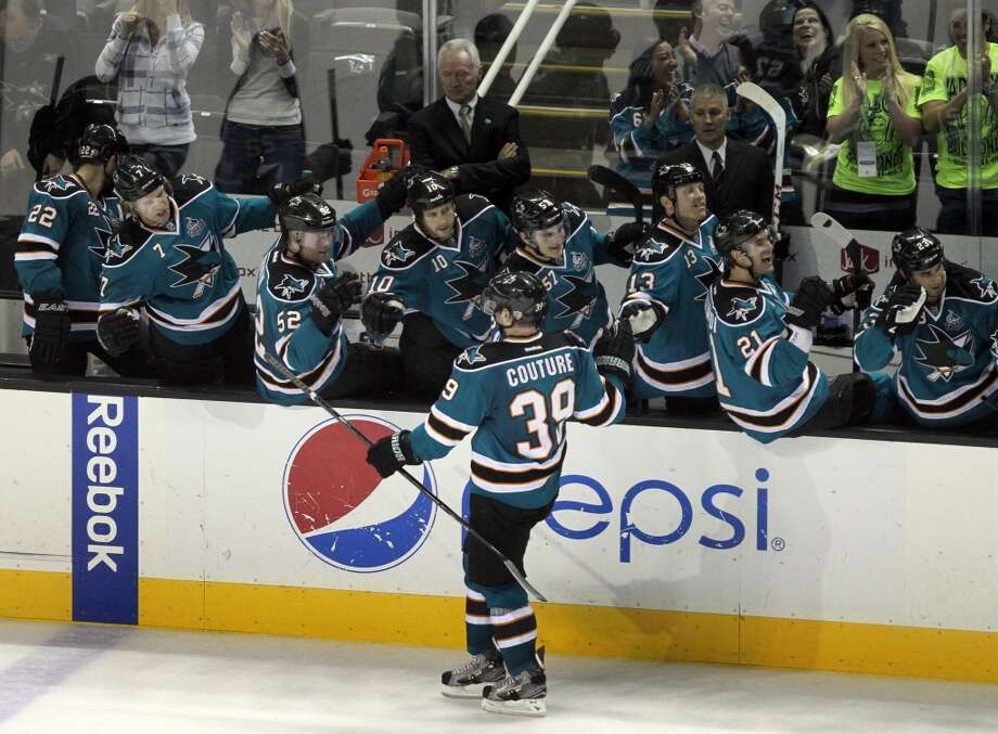 Logan Couture #39 of the San Jose Sharks celebrates his third period goal with teammates during their NHL game with the Dallas Stars at HP Pavilion on Tuesday, April 23, 2013 in San Jose, California.