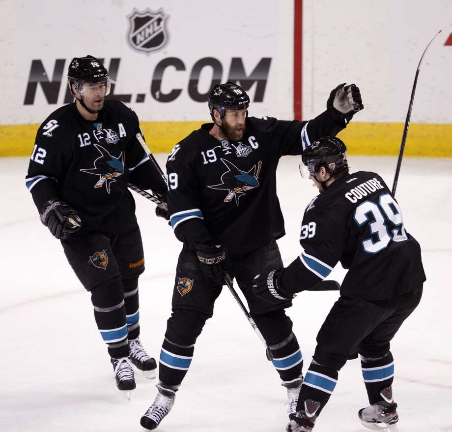 Joe Thornton (19) celebrates his goal with Patrick Marleau (12) and Logan Couture (39) in the first period. The San Jose Sharks played the Los Angeles Kings at HP Pavilion in San Jose, Calif., on Sunday, May 26, 2013, in Game 6 of the NHL Western Conference Semifinals.