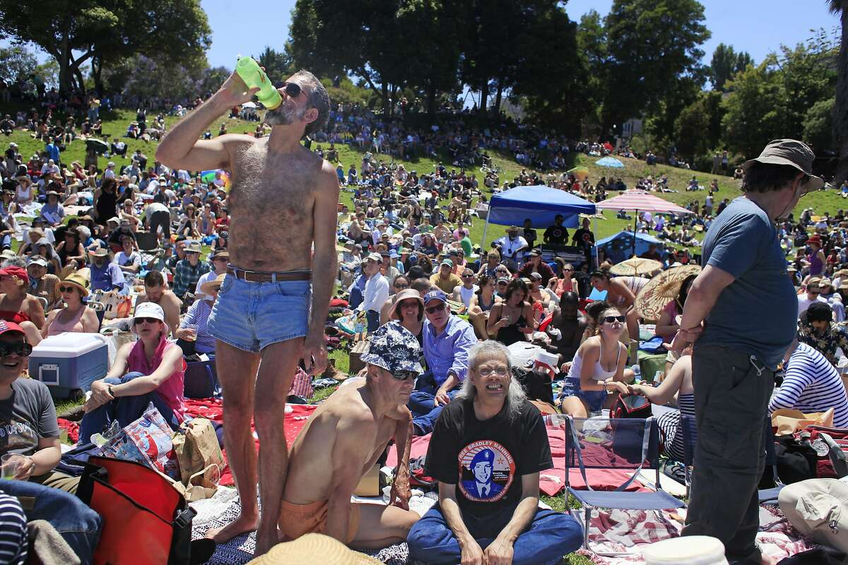 John Daniel, Chuck Bierwirth and Jerry the Faerie wait for the SF Mime Troupe to kick off its free summer in the parks at Dolores Park on Thursday July 4, 2013 in San Francisco, Calif. This year the show is a two one-acts called Oil & Water. The first act is called