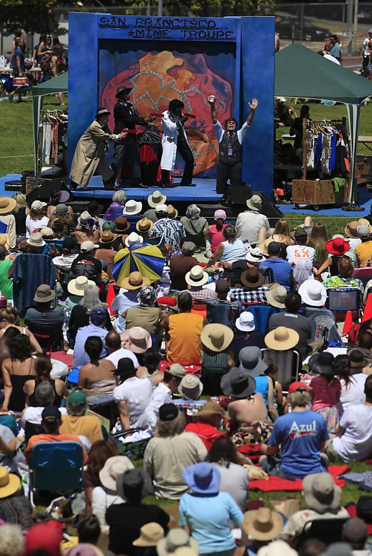 """Opens July 4: The SF Mime Troupe kicks off its 55th season with """"Ripple Effect"""" in Dolores Park July 4-5 before moving to Yerba Buena on July 6 and the rest of the Bay Area throughout the summer. The schedule is here."""