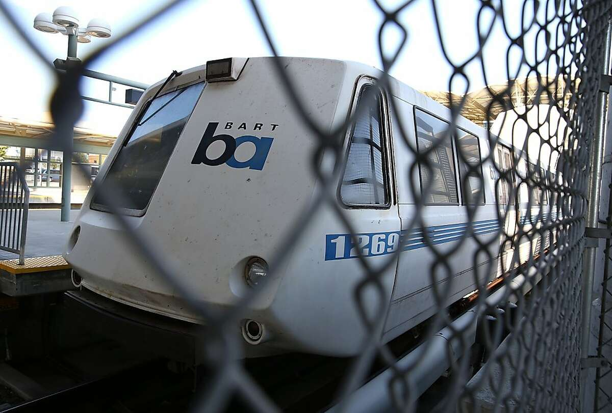 MILLBRAE, CA - JULY 03: A Bay Area Rapid Transit (BART) train sits idle at the Millbrae station on July 3, 2013 in Millbrae, California. For a third day, hundreds of thousands of San Francisco Bay Area commuters are scrambling to find ways to work as two of San Francisco Bay Area Rapid Transit's (BART) largest unions remain on strike while they continue contract negotiations with management. Train operators, mechanics, station agents and maintenance workers are seeking a five percent wage increase and are fighting management who want to have workers to begin contributing to their pensions, pay more for health insurance and reduce overtime expenses. (Photo by Justin Sullivan/Getty Images)