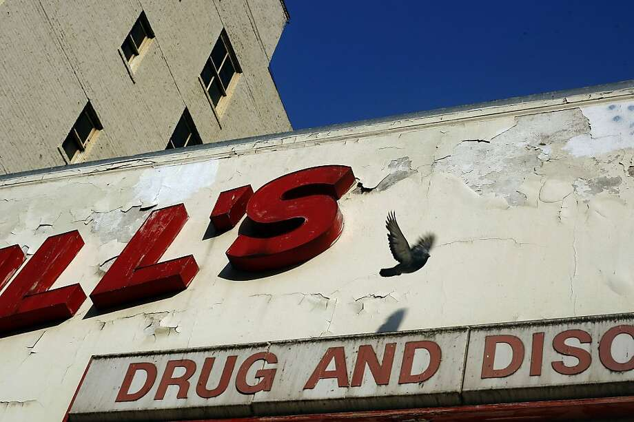 Merrill's Drug Store, vacant since 2004 and a haven for roosting pigeons, has been sold, as have other properties on the block. Photo: Rohan Smith, The Chronicle