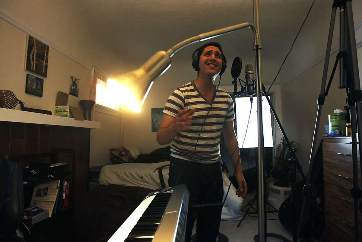 """Andrew Levin shoots a video for his song """"What I'd do"""", which he'll be uploading to a new website called Piglt; a crowdfunding platform for higher education expenses and student debt on Sunday, June 23, 2013 in Oakland, Calif. Levin sings along to his song in the makeshift video set in his bedroom."""