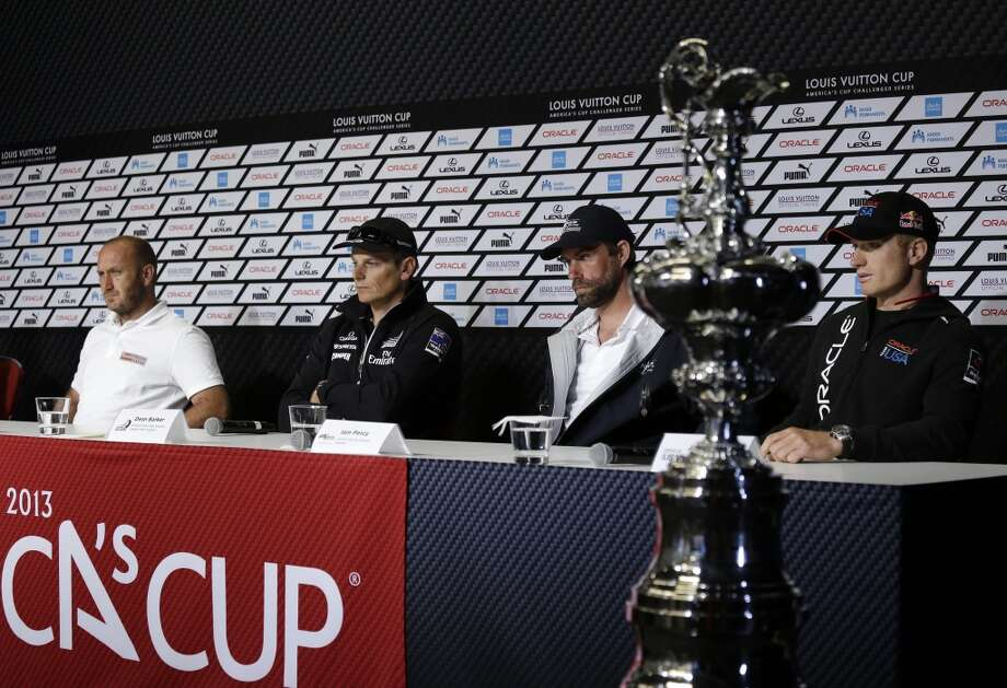 From left, Max Sirena, of Luna Rossa Challenge, from Italy; Dean Barker, of Emirates Team New Zealand; Iain Percy, of Artemis Racing, from Sweden; and Jimmy Spithill, of Oracle Team USA, take questions during a news conference of the America's Cup sailing  skippers Friday, July 5, 2013, in San Francisco. The first race in the challenger series is scheduled for Sunday. (AP Photo/Eric Risberg)