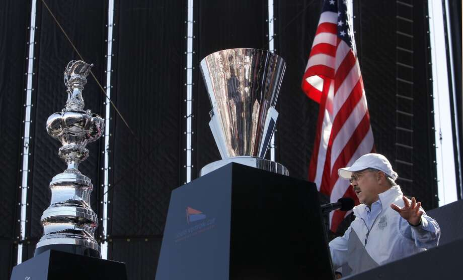 San Francisco Mayor Ed Lee welcomes all to the city, in front is the America's Cup trophy, (left) along with the Louis Vuitton trophy, during the opening day ceremony at America's Cup Park in San Francisco, Calif., on Thursday July 4, 2013. America's Cup Park opens along the Embarcadero launching the first day of the summer of racing.