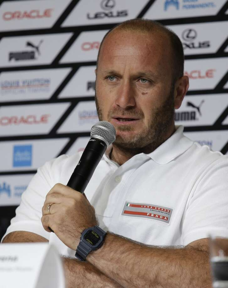 Max Sirena, skipper of Luna Rossa Challenge, from Italy, announces that his team might not race Sunday, during a news conference of the America's Cup sailing skippers Friday, July 5, 2013, in San Francisco. The first race in the challenger series is scheduled for Sunday. (AP Photo/Eric Risberg)
