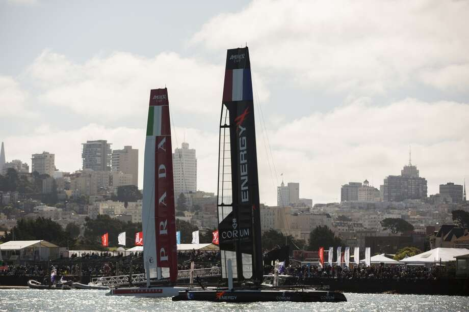 Italy's Luna Rossa Piranha, left, and France's Energy Team stand in front of Marina Green during the America's Cup World Series in San Francisco Bay, Calif. on Sunday, Aug. 26, 2012.