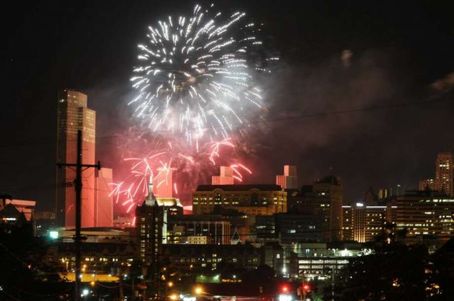 Fireworks light up the sky over Albany Thursday afternoon, July 4, 2013, during New York State's 4th of July Celebration Presented By Price Chopper at the Empire State Plaza. Photo taken in in Rensselaer, N.Y. (Will Waldron / Times Union)