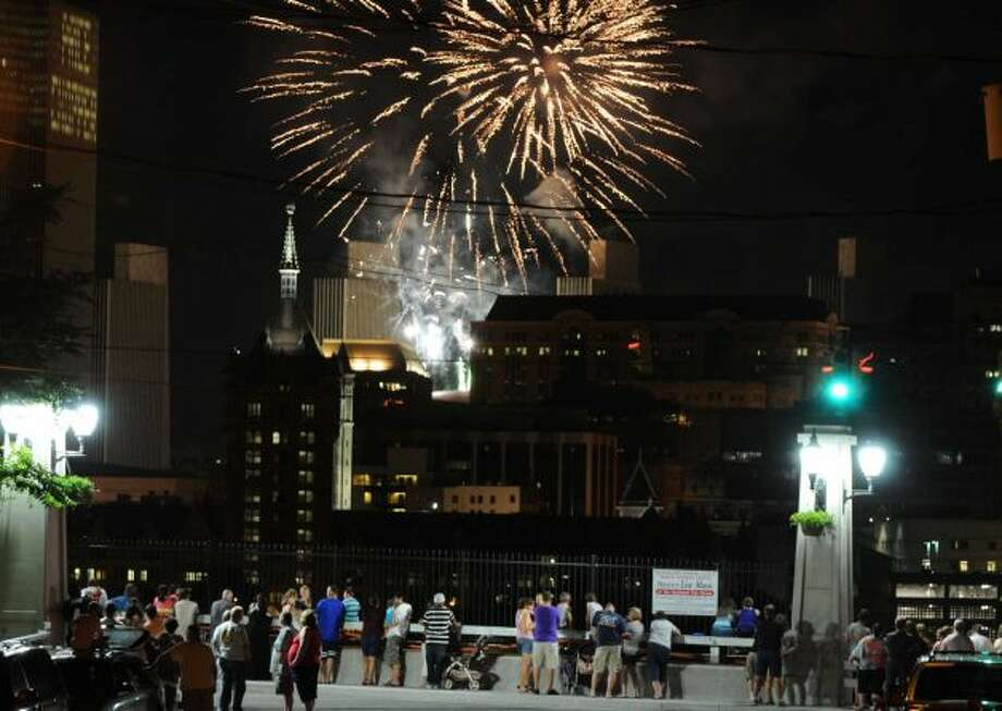 Fireworks light up the sky over Albany Thursday, July 4, 2013, during New York State's 4th of July Celebration Presented By Price Chopper at the Empire State Plaza. People came out onto the streets in Rensselaer, N.Y. to view the colorful Fourth of July display. (Will Waldron / Times Union)