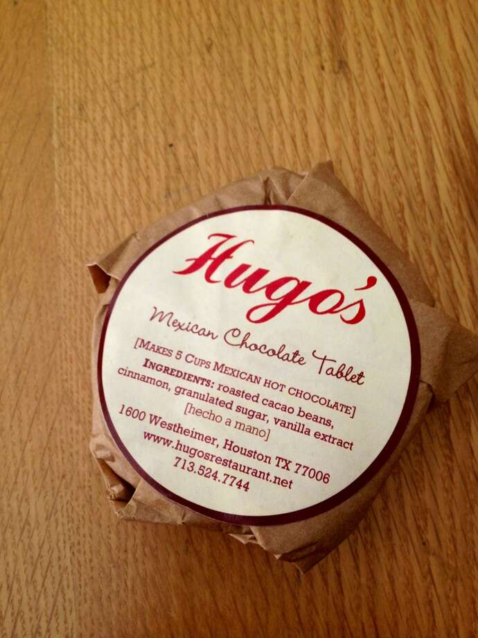 "Hugo's restaurant sells ""chocolate tablets"" -- rounds of homemade chocolate used to make Mexican hot chocolate."