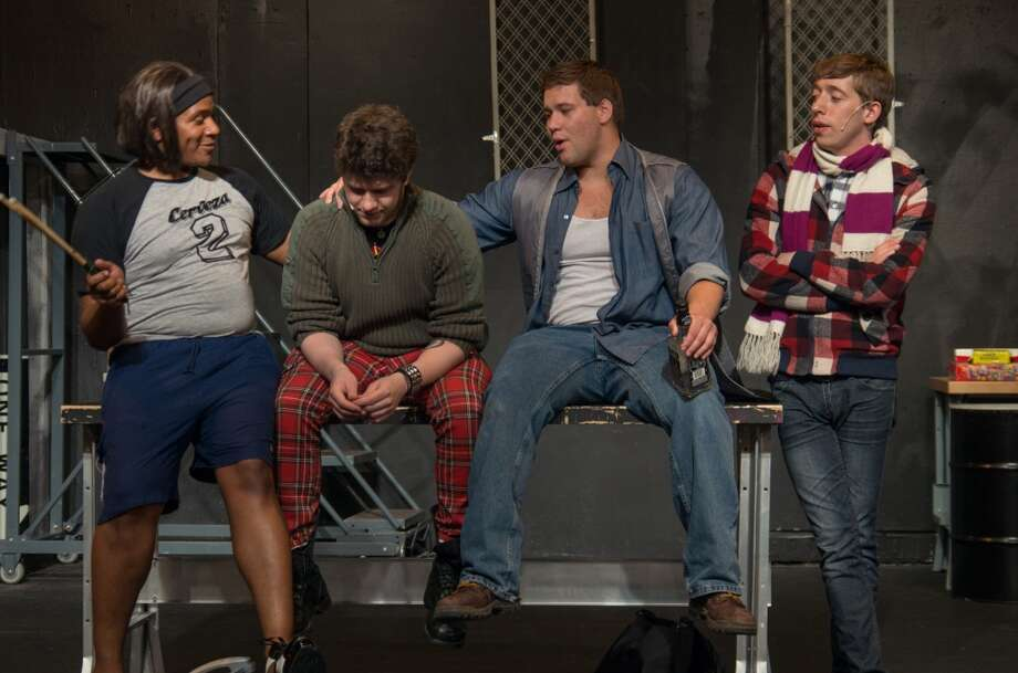 From left, Torrey Thomas (Angel), Bennett Cognato (Roger), Nick Kuell (Tom) and Rob Bassett (Mark) rehearse a scene from Rent at Brookfield Theatre in Brookfield, Conn. Visit www.brookfieldtheatre.org.