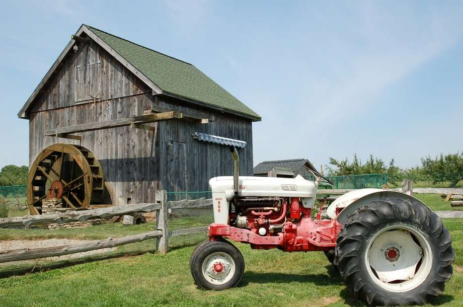 "The Connecticut Trust for Historic Preservation has published a Barns Trail self-guided tour brochure that directs day-trippers to ""significant"" barns throughout the state, including this New England-style barn with waterwheel at Rose Orchards in North Branford."