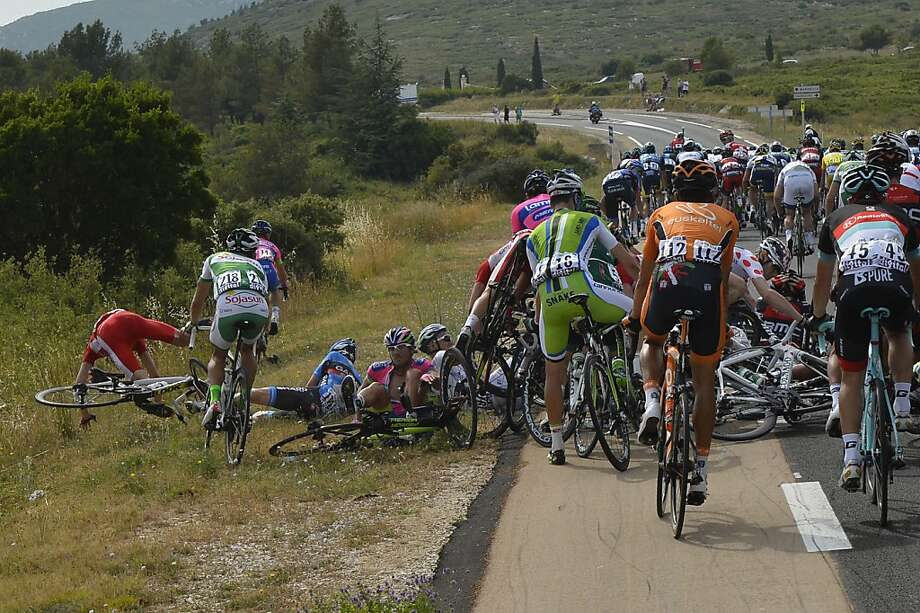 Sometimes the pack gets packed too tightly during the Tour de France, and this happens. (Fifth stage, Cagnes-sur-Mer to  Marseille.) Photo: Jerome Prevost, Associated Press