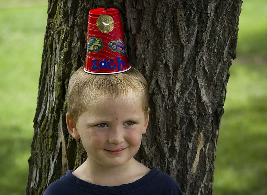 Don't tell him it's upside-down beer cup: Five-year-old Zachary Collins proudly wears his new Shriner fez, which he decorated at a Kids Day booth at ShrinersFest in Evansville, Ind. Photo: Denny Simmons, Associated Press
