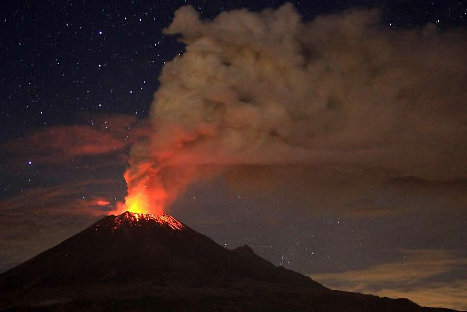 Nice of Mexico's Popocatepetl Volcano to celebrate the Fourth with us. (San Mateo Ozolco, in the Mexican central state of Puebla.) Photo: Pablo Spencer, AFP/Getty Images