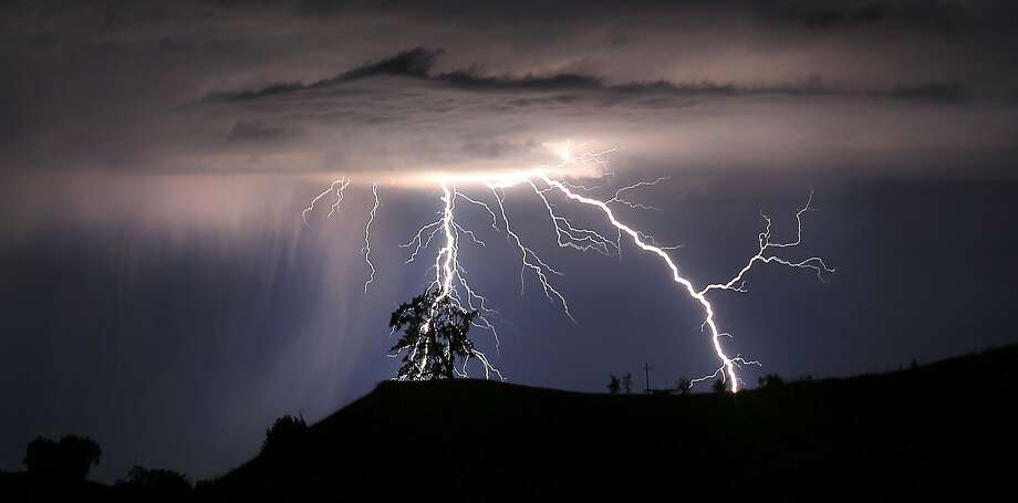 Lightning strikes above the Geysers area of northern Sonoma County. Photo: Kent Porter, Santa Rosa Press Democrat Via AP