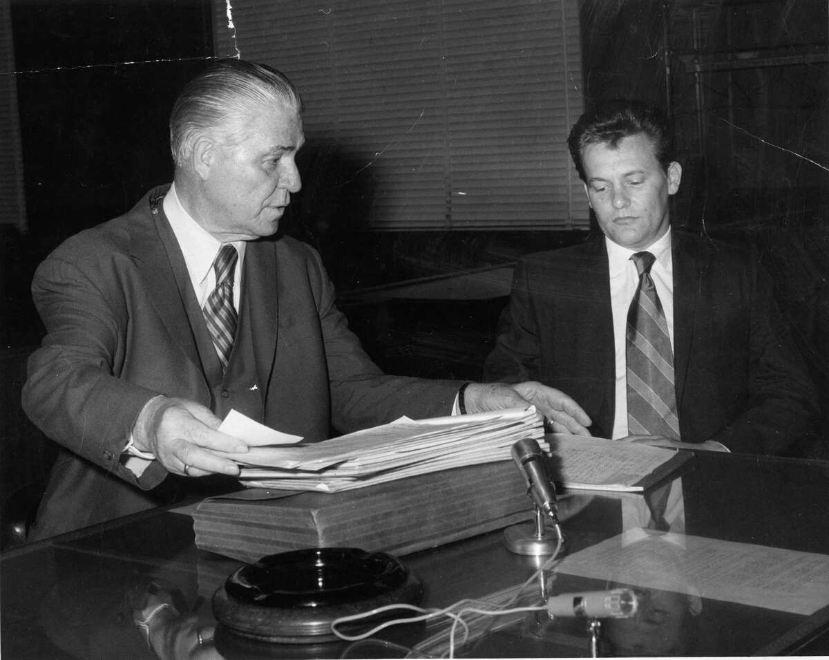 07/08/1970 - Charles V. Harrelson, right, confers with his attorney Percy Foreman. Harrelson is accused in the murder of Houston carpet executive Alan Harry Berg.