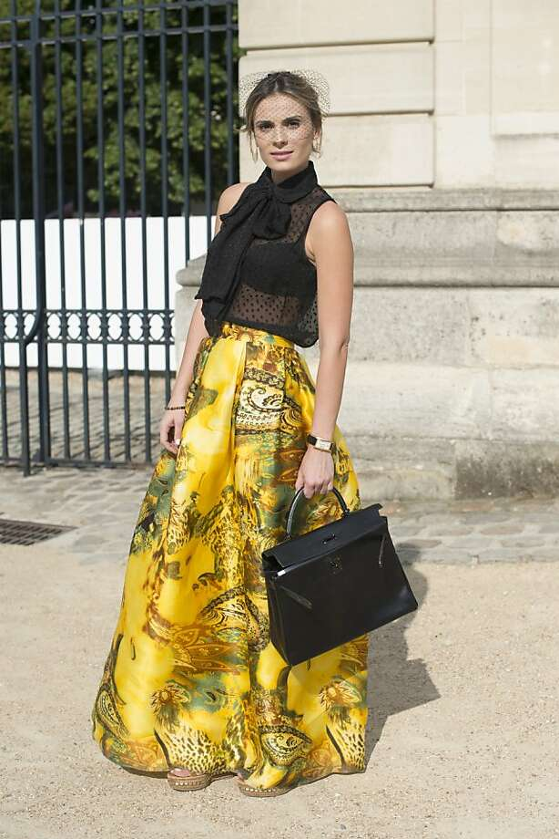 Brand Consultant Wilma Helena Faisson wears Christian Louboutin shoes, a Hermes bag, Mixed top, Custom made skirt and Dior headpiece on day 1 of Paris Collections: Women's Haute Couture on July 01, 2013 in Paris, France.  (Photo by Kirstin Sinclair/FilmMagic) Photo: Kirstin Sinclair, FilmMagic