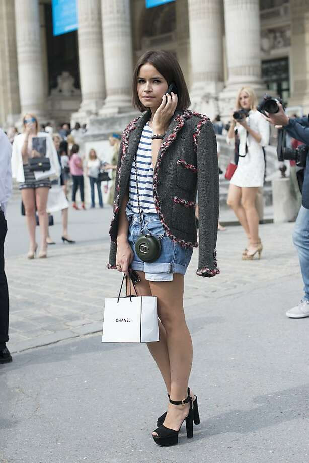 Fashion writer and Founder of Buro 247 Russia Miroslava Duma wears a Chanle jacket and bag with Levi's shorts on day 2 of Paris Collections: Women's Haute Couture on July 02, 2013 in Paris, France. Photo: Kirstin Sinclair, FilmMagic