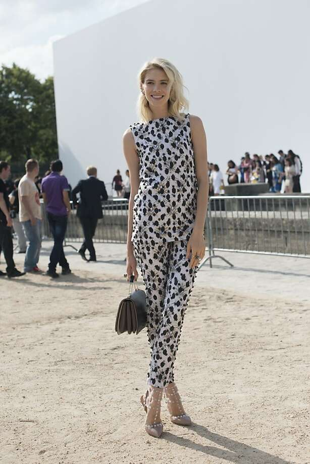 Model Elena Perminova wears Valentino shoes, Emilio Pucci bag and a Giambattista Valli jumpsuit on day 1 of Paris Collections: Women's Haute Couture on July 01, 2013 in Paris, France.  (Photo by Kirstin Sinclair/FilmMagic) Photo: Kirstin Sinclair, FilmMagic