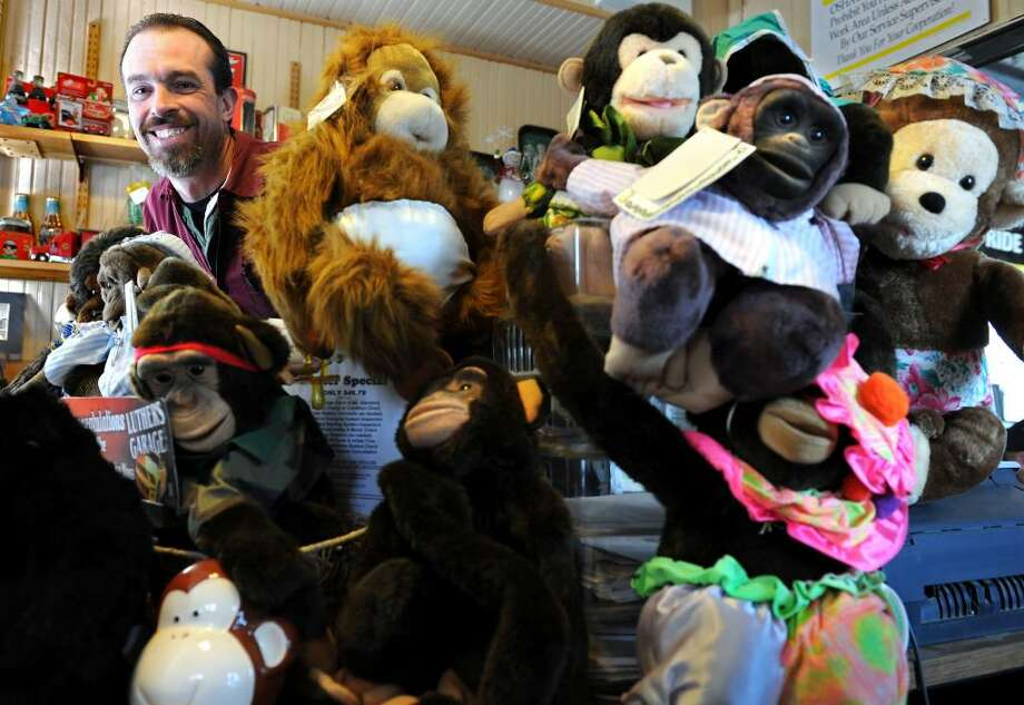 John Landry, owner of Luther's Garage in Shelton, has been collecting stuffed monkeys for children in local hospitals and safe houses for his 4th Annual Monkey Love Valentine Drive. Photo: Autumn Driscoll / Connecticut Post