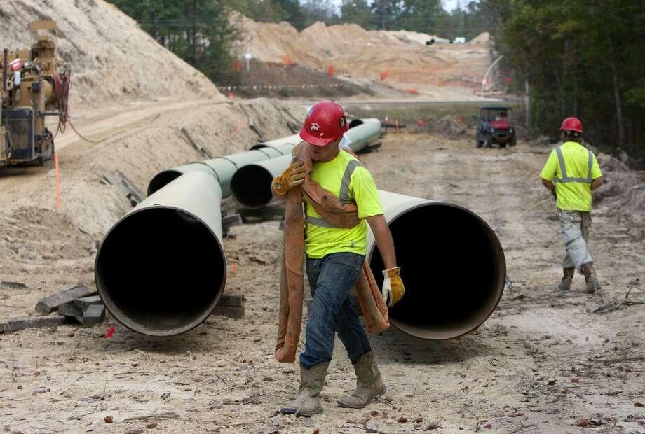 Crewmen work a site for TransCanada's Keystone XL project in Wood County, Wednesday, Oct. 24, 2012, in Winnsboro. (Cody Duty / Houston Chronicle) Photo: Cody Duty, Staff / Houston Chronicle