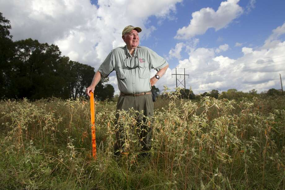 A stake marks where TransCanada's Keystone XL pipeline will come through Marshall Treadwell's 800-acre tree and hay farm near Sacul, northeast of Nacogdoches. He welcomes the oil that will flow to Texas and the jobs that will come with it. Photo: Cody Duty, Staff / Houston Chronicle