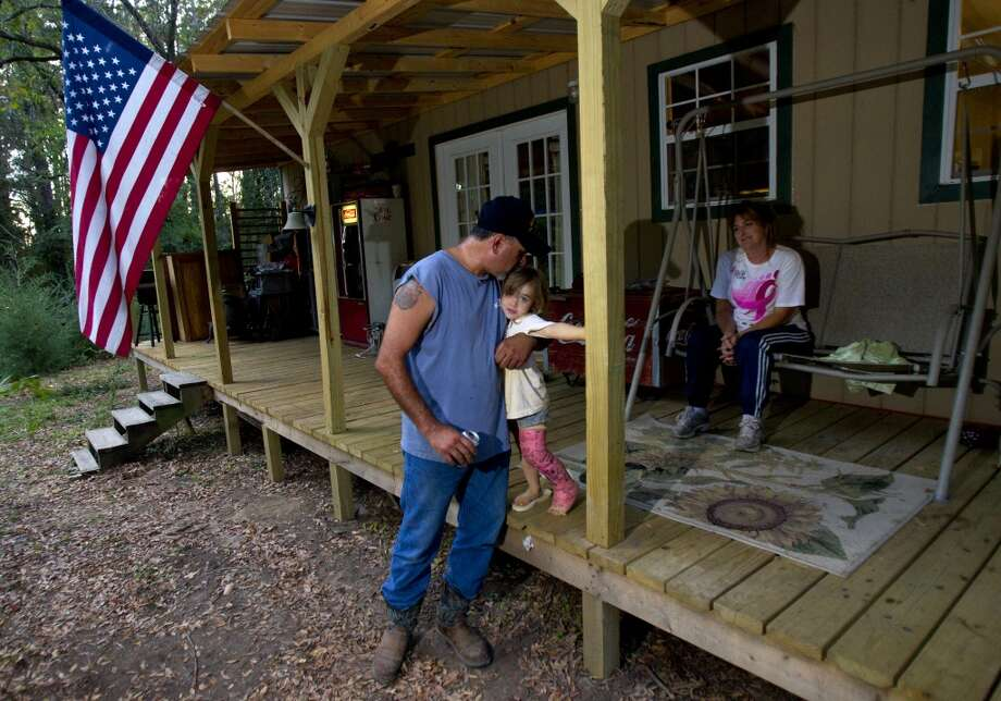 Gabe Cordova, and his daughter, Ayden, and wife, Carla, live on his mother's property in Wood County. They're resigned to TransCanada building its Keystone XL on his mother's land, whether they like it or not. Photo: Cody Duty, Staff / Houston Chronicle