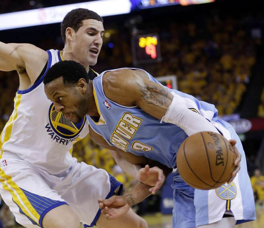 Denver Nuggets' Andre Iguodala, right, is defended by Golden State Warriors' Klay Thompson during the second half of Game 6 in a first-round NBA basketball playoff series in Oakland, Calif., Thursday, May 2, 2013.