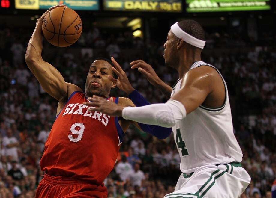 Andre Iguodala of the Philadelphia 76ers drives to the basket against Paul Pierce in Game Seven of the Eastern Conference Semifinals during the 2012 NBA Playoffs.