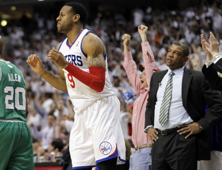 Philadelphia 76ers forward Andre Iguodala reacts after his basket as Boston Celtics coach Doc Rivers, right, looks on in the second half of Game 4 of an NBA basketball Eastern Conference semifinal playoff series in 2012.