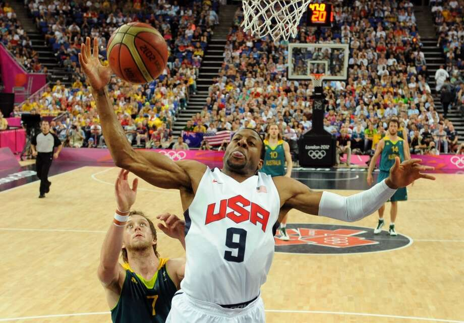 United States' forward Andre Iguodala, front, is challenged by Australia's forward Joe Ingles during their men's quarterfinal basketball game at the 2012 Summer Olympics.